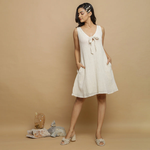 Front View of a Model wearing Undyed Cotton Deep Neck A-Line Dress