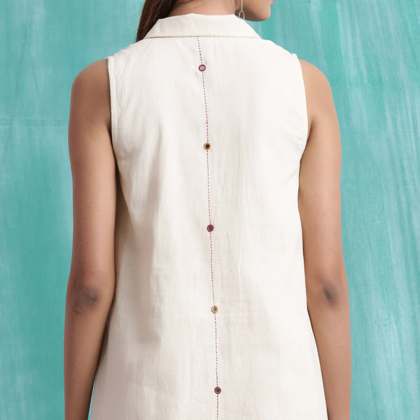 Back Detail of a Model wearing Undyed Handspun Mirror Work Shirt Dress
