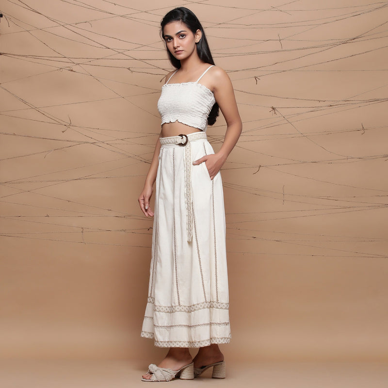 Left View of a Model wearing Undyed Cotton Jute Laced Flared Skirt