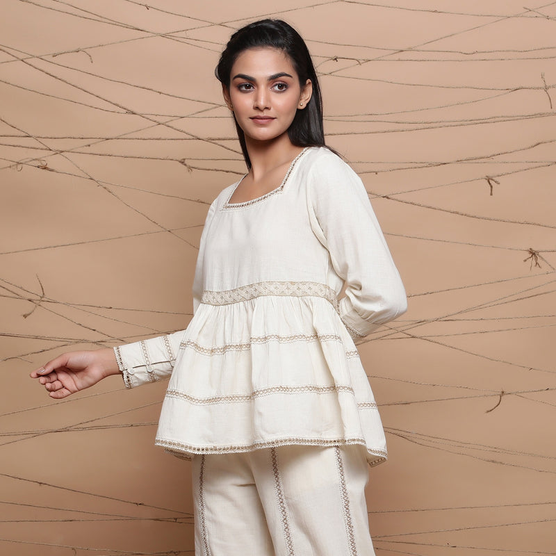 Left View of a Model wearing Undyed Cotton Jute Laced Peplum Top