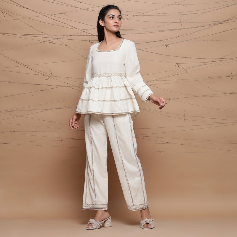 Front View of a Model wearing Undyed Cotton Jute Laced Peplum Top