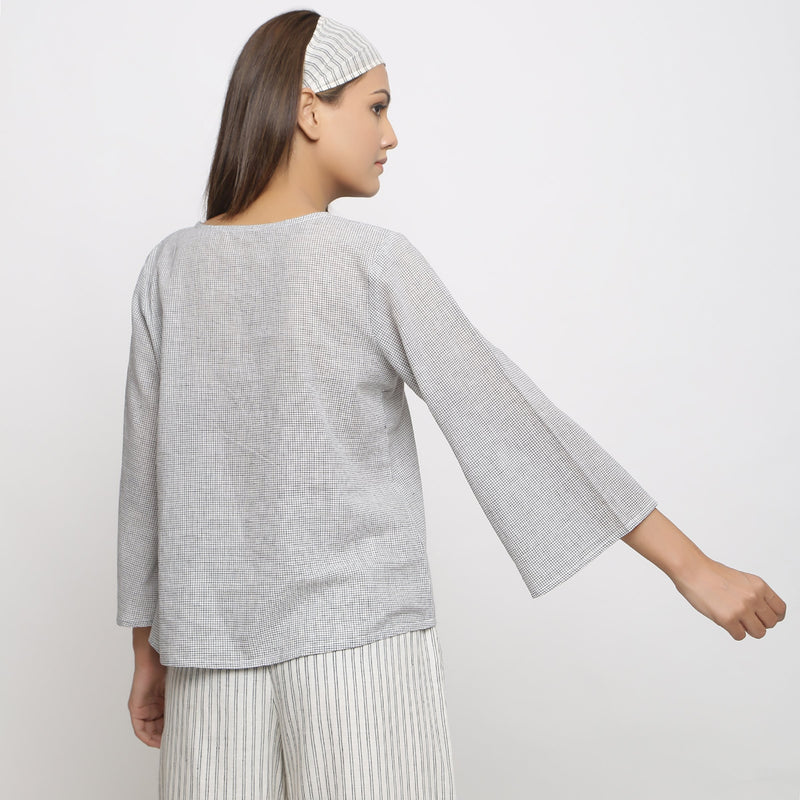 Back View of a Model wearing Off-White Handwoven Cotton V-Neck Top