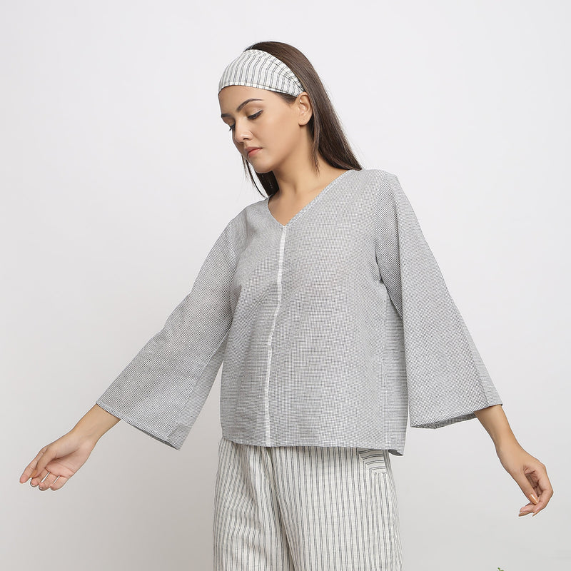 Left View of a Model wearing Off-White Handwoven Cotton V-Neck Top