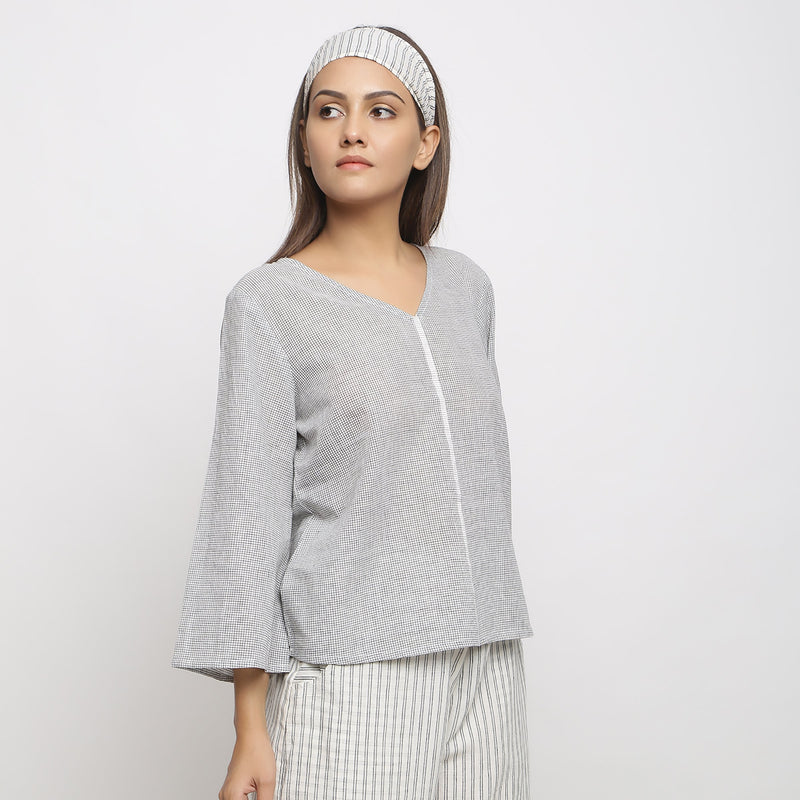 Right View of a Model wearing Off-White Handwoven Cotton V-Neck Top