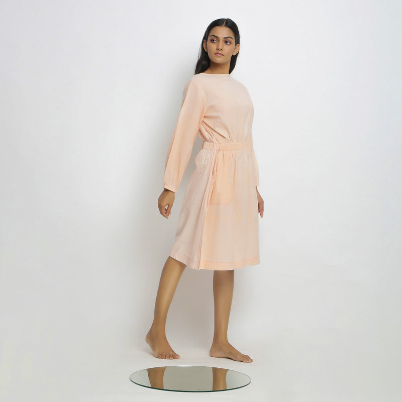 Right View of a Model wearing Vegetable Dyed Bishop Sleeves Dress