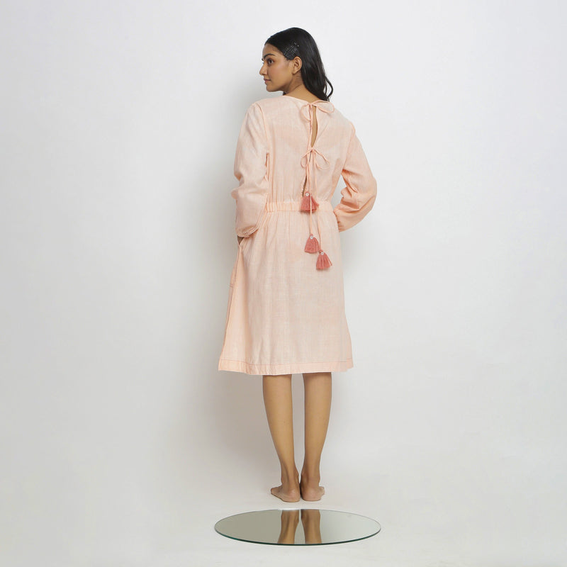 Back View of a Model wearing Vegetable Dyed Bishop Sleeves Dress