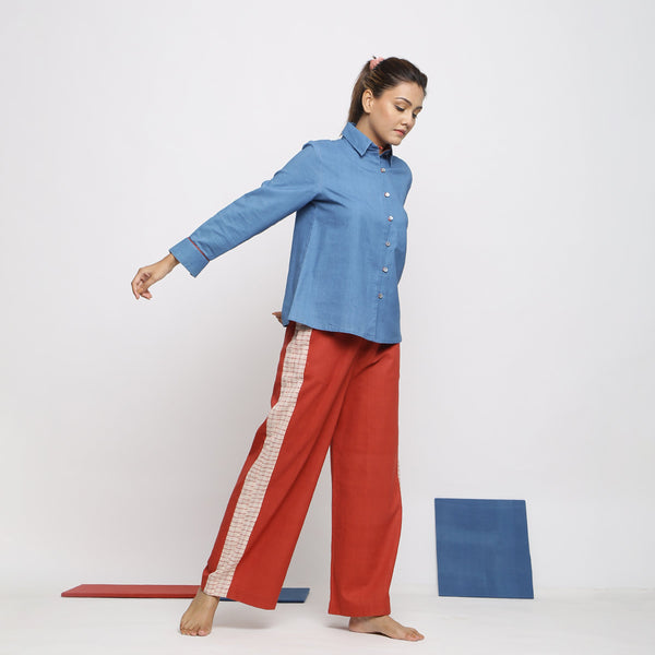 Right View of a Model wearing Vegetable Dyed Blue Shirt and Brick Red Pant Set