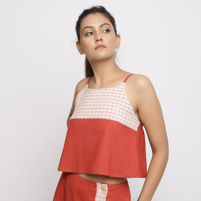 Left View of a Model wearing Vegetable Dyed Brick Red Spaghetti Top