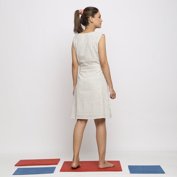 Back View of a Model wearing Vegetable Dyed Ecru Button-Down Dress
