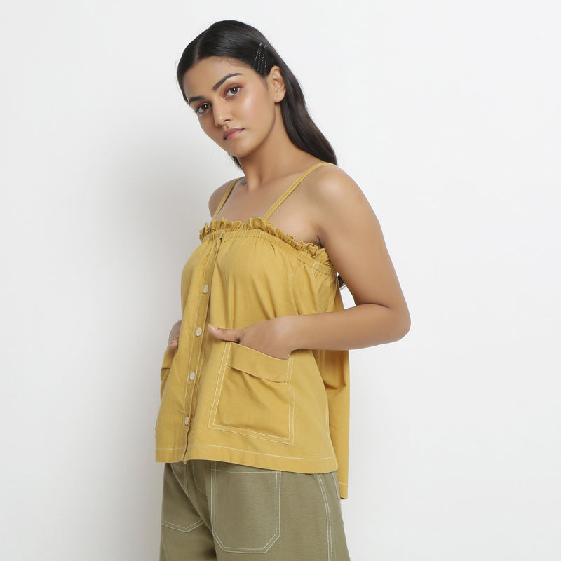 Left View of a Model wearing Vegetable Dyed Button-Down Camisole Top