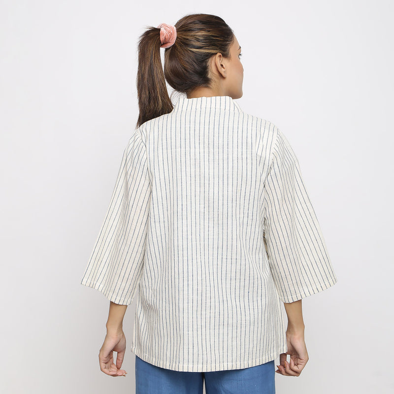 Back View of a Model wearing Vegetable Dyed Cotton Asymmetrical Outerwear