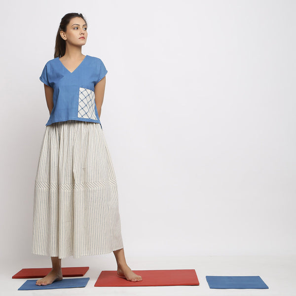 Front View of a Model wearing Vegetable-Dyed Off-White Gathered Skirt