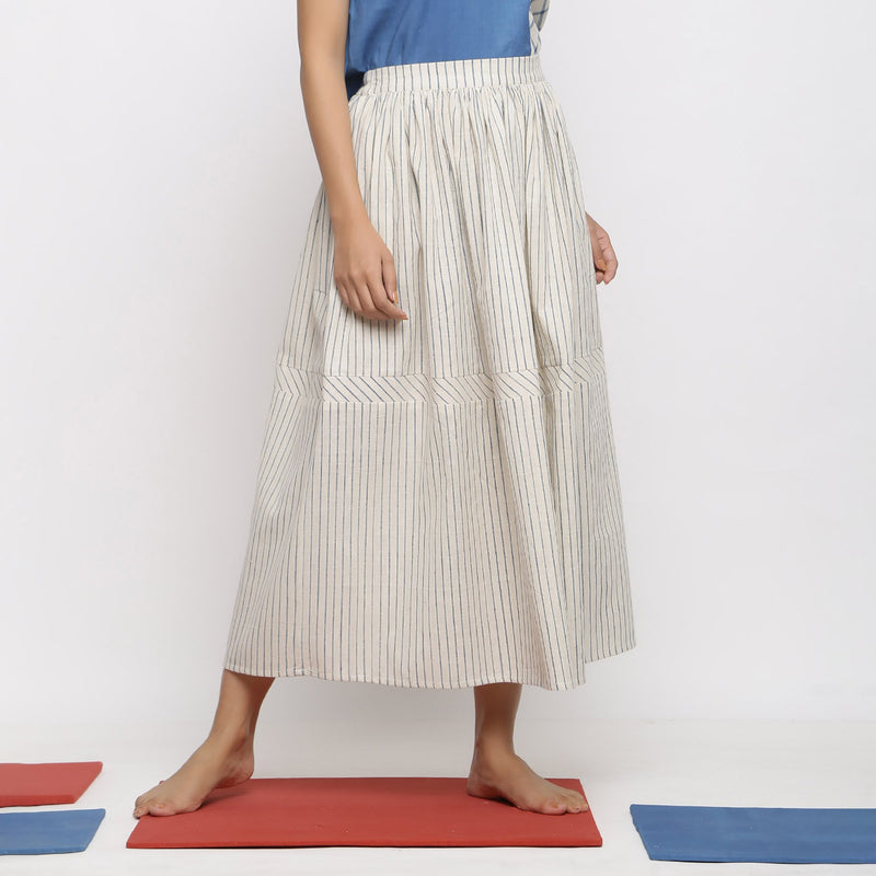 Right View of a Model wearing Vegetable Dyed Off-White Gathered Skirt