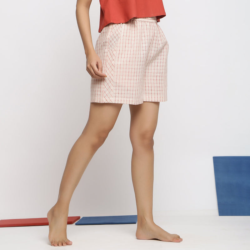 Right View of a Model wearing Vegetable Dyed Off-White Paneled Shorts