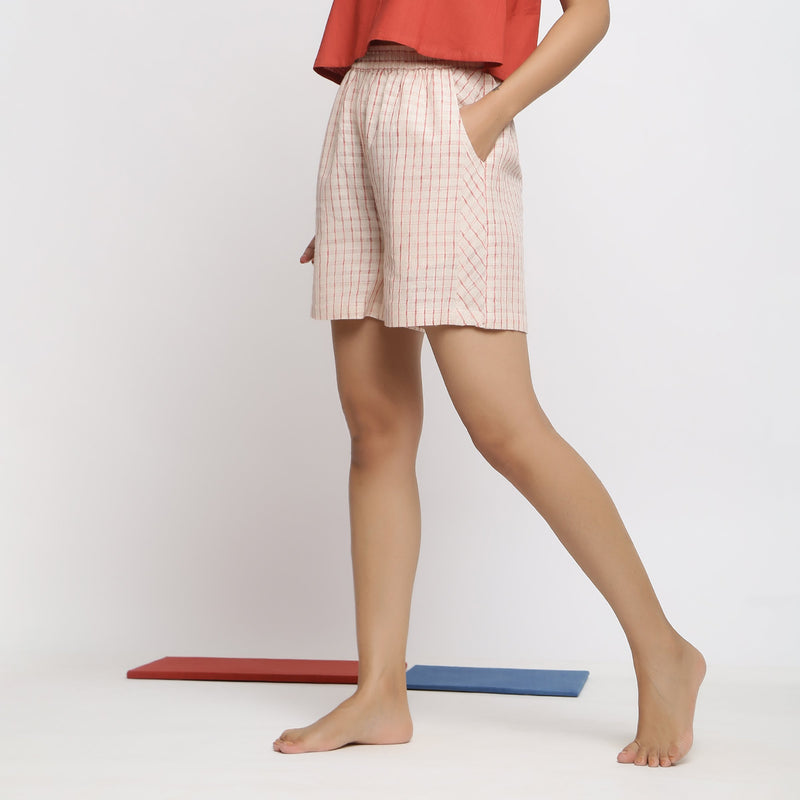 Left View of a Model wearing Vegetable Dyed Off-White Paneled Shorts