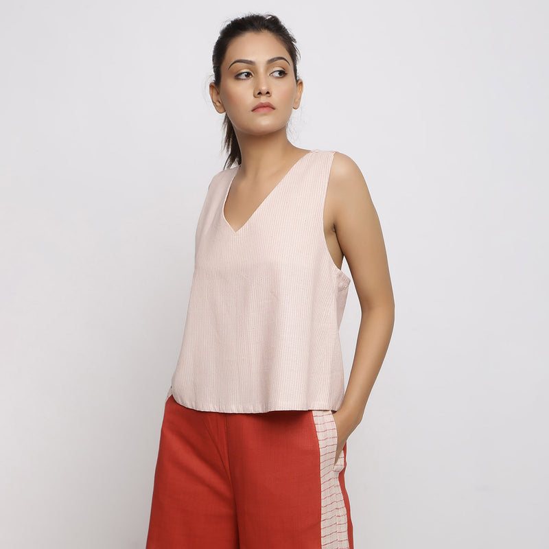 Left View of a Model wearing Vegetable Dyed Pink Deep Neck Top