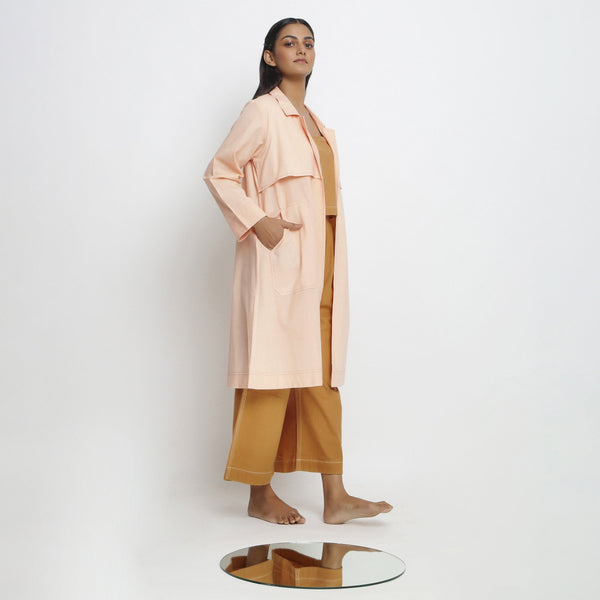 Right View of a Model wearing Vegetable Dyed Powder Pink Paneled Overlay