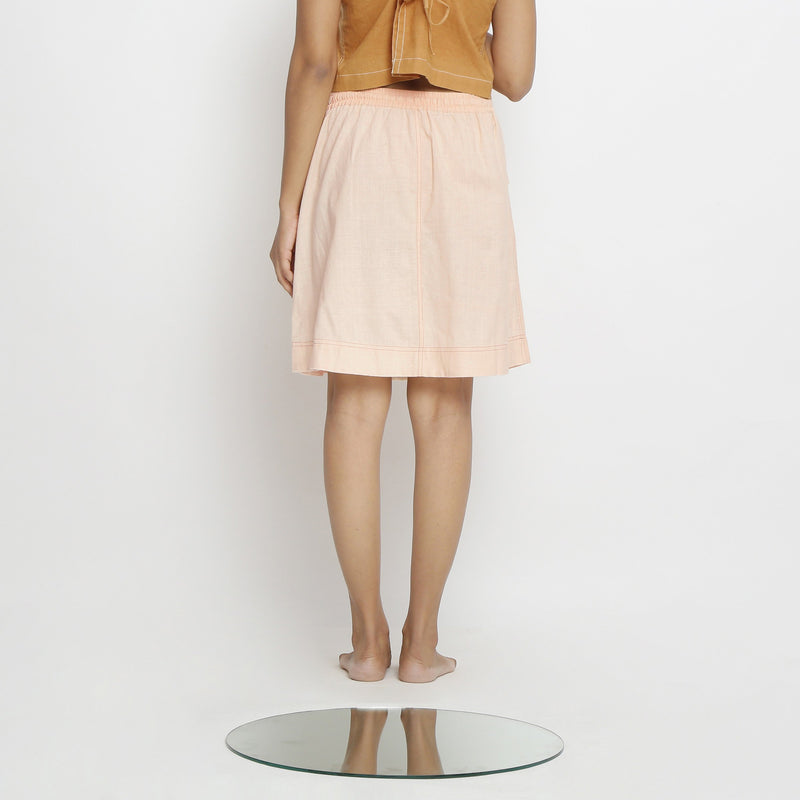 Back View of a Model wearing Vegetable Dyed Powder Pink Mid Rise Skirt