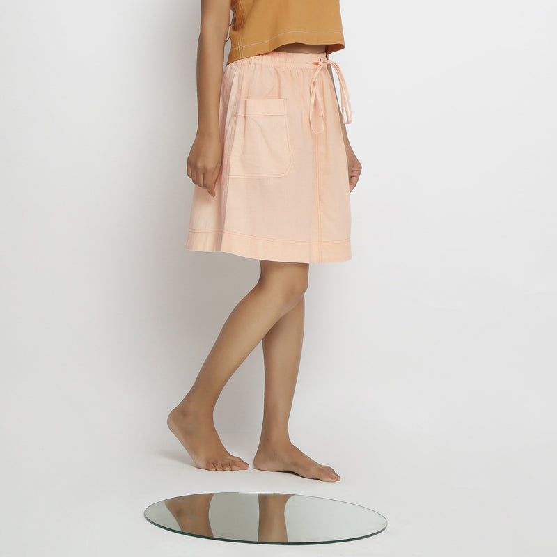Rightt View of a Model wearing Vegetable Dyed Powder Pink Mid Rise Skirt