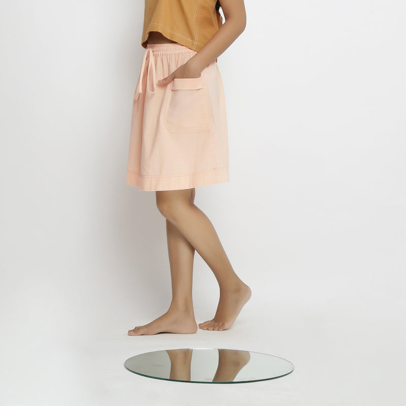 Left View of a Model wearing Vegetable Dyed Powder Pink Mid Rise Skirt