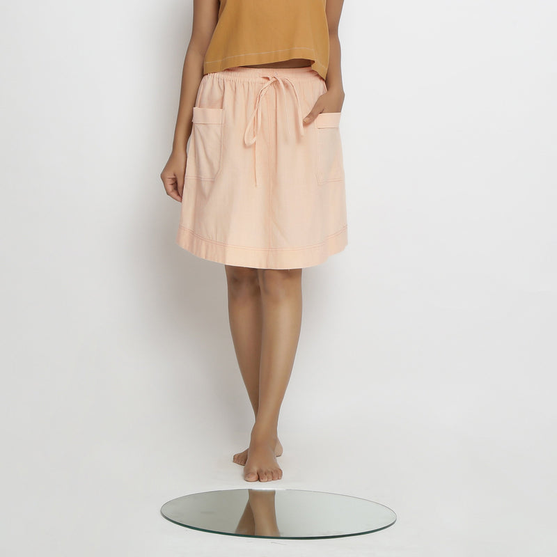 Front View of a Model wearing Vegetable Dyed Powder Pink Mid Rise Skirt