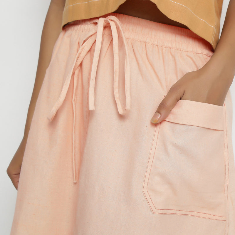 Front Detail of a Model wearing Vegetable Dyed Powder Pink Mid Rise Skirt