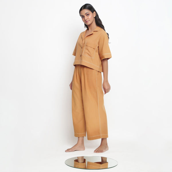 Left View of a Model wearing Vegetable Dyed Rustic Wide Legged Pant