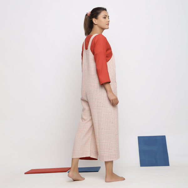 Back View of a Model wearing Vegetable Dyed Striped Pinafore Jumpsuit