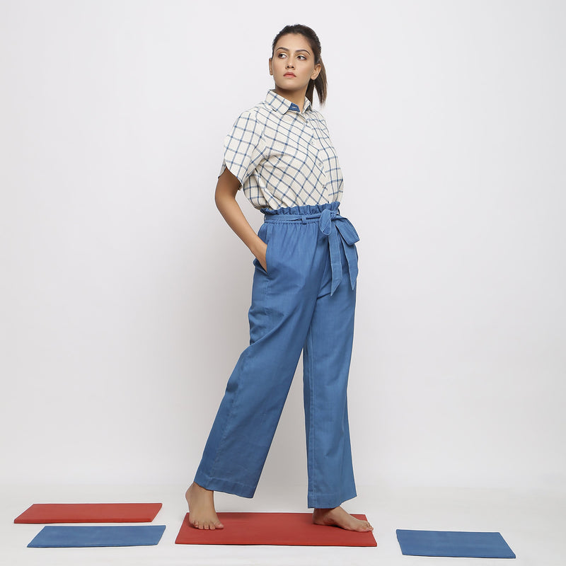 Right View of a Model wearing Vegetable Dyed Wide Legged Paperbag Pant