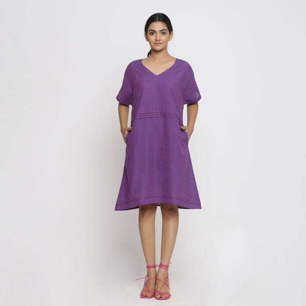 Front View of a Model wearing Violet Cotton V-Neck Pleated Dress