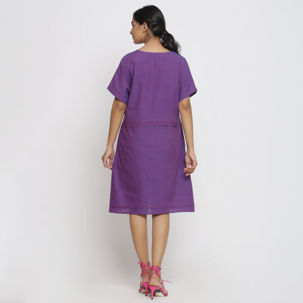 Back View of a Model wearing Violet Cotton V-Neck Pleated Dress