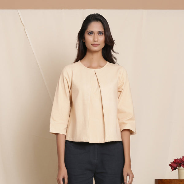 Front View of a Model wearing Warm Flannel Dusk Beige Box-Pleat Top