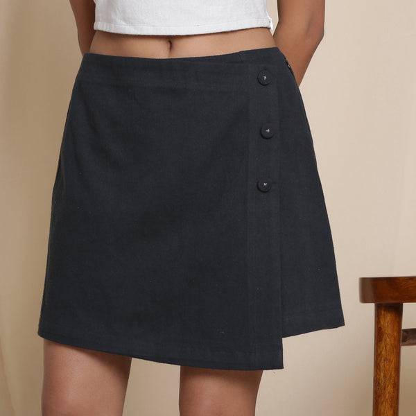 Front Detail of a Model wearing Warm Flannel Moonlight Black Overlap Skirt