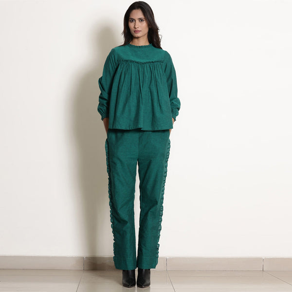 Front View of a Model wearing Warm Green Frilled Gathered Yoked Top