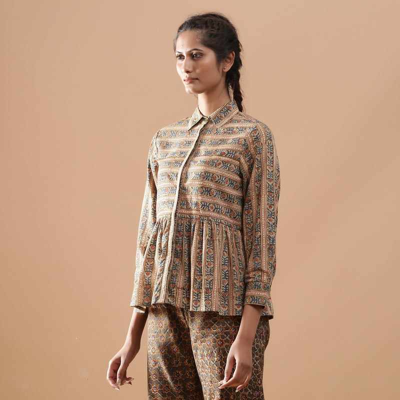 Left View of a Model wearing Warm Striped Floral Kalamkari Shirt