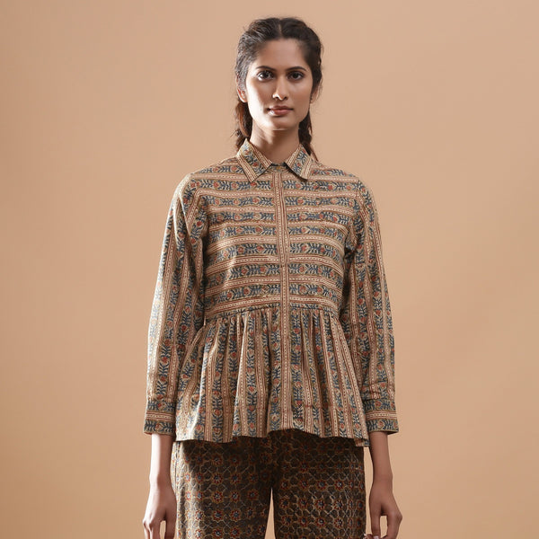 Front View of a Model wearing Warm Striped Floral Kalamkari Shirt