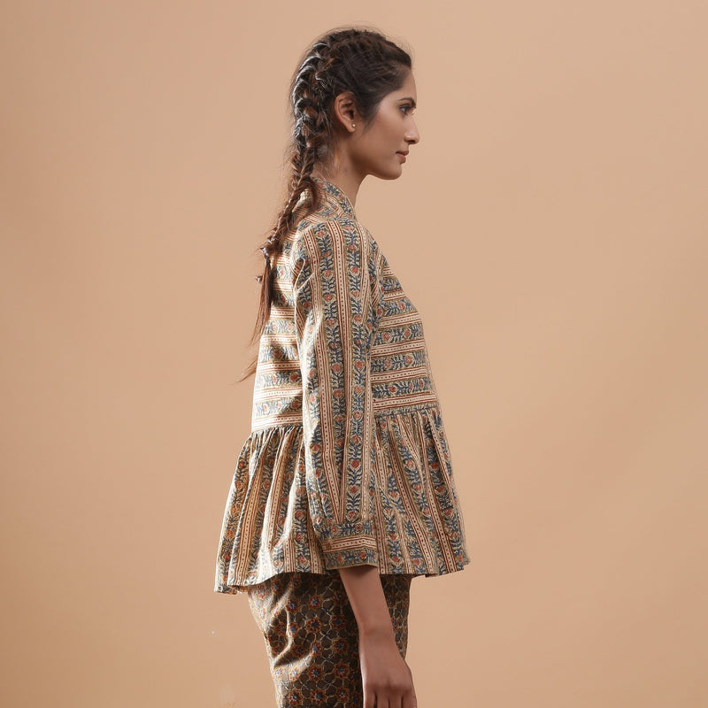 Right View of a Model wearing Warm Striped Floral Kalamkari Shirt