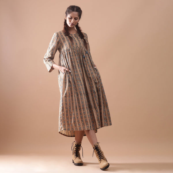 Front View of a Model wearing Warm Gathered Kalamkari Midi Dress