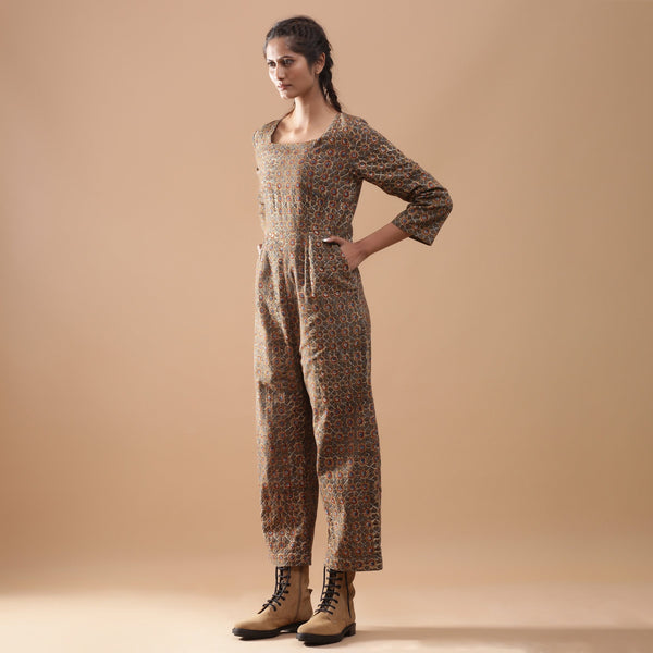 Left View of a Model wearing Warm Muddy Green Kalamkari Cotton Jumpsuit