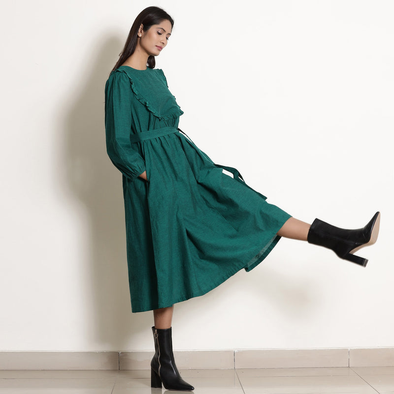 Right View of a Model wearing Warm Pine Green Frilled Yoke Dress