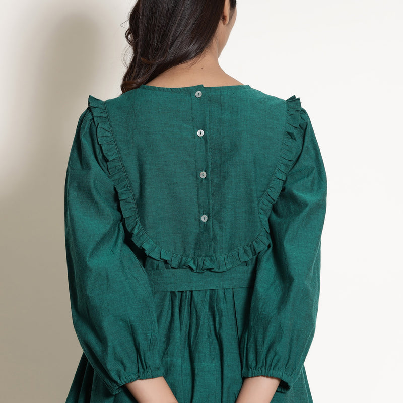 Back View of a Model wearing Warm Pine Green Frilled Yoke Dress