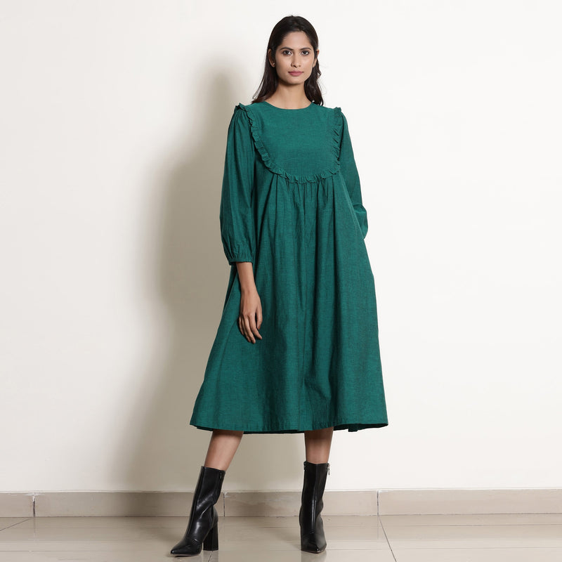 Front View of a Model wearing Warm Pine Green Frilled Yoke Dress