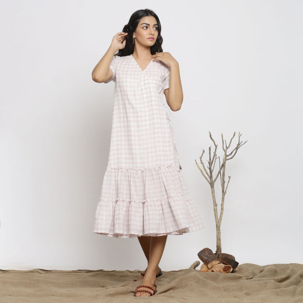 Front View of a Model wearing White And Pink Handspun Wrap Dress