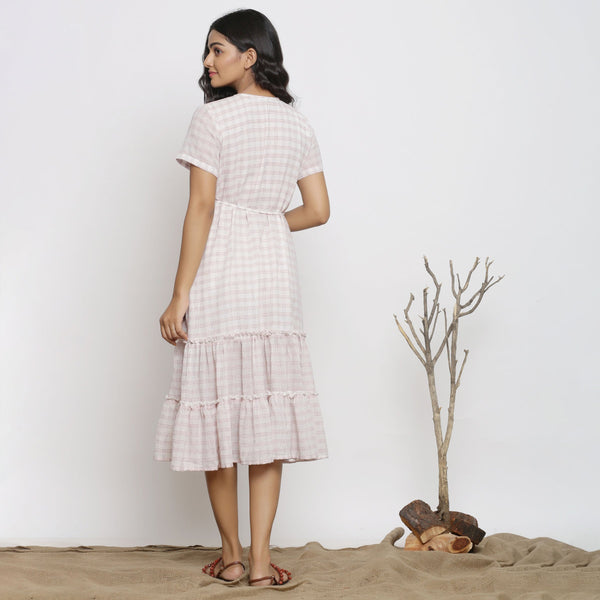 Back View of a Model wearing White And Pink Handspun Wrap Dress