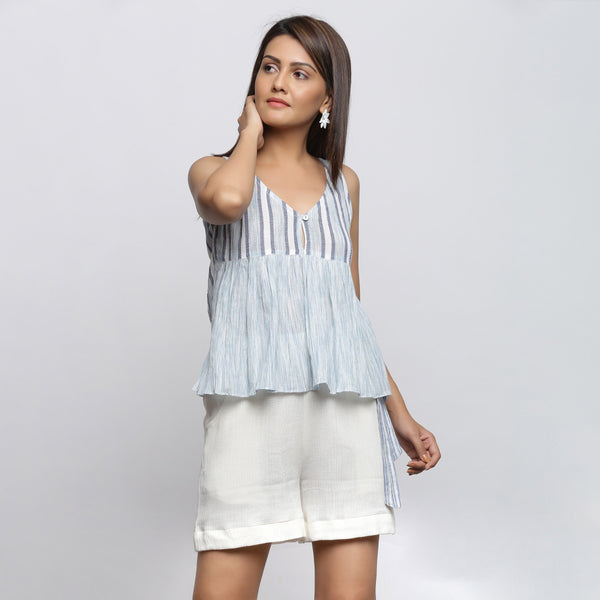 Front View of a Model wearing White And Sky Blue Yarn Dyed Gathered Top
