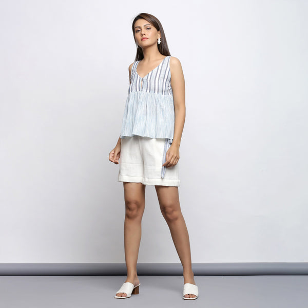 Front View of a Model wearing White and Blue Yarn Dyed Gathered Top