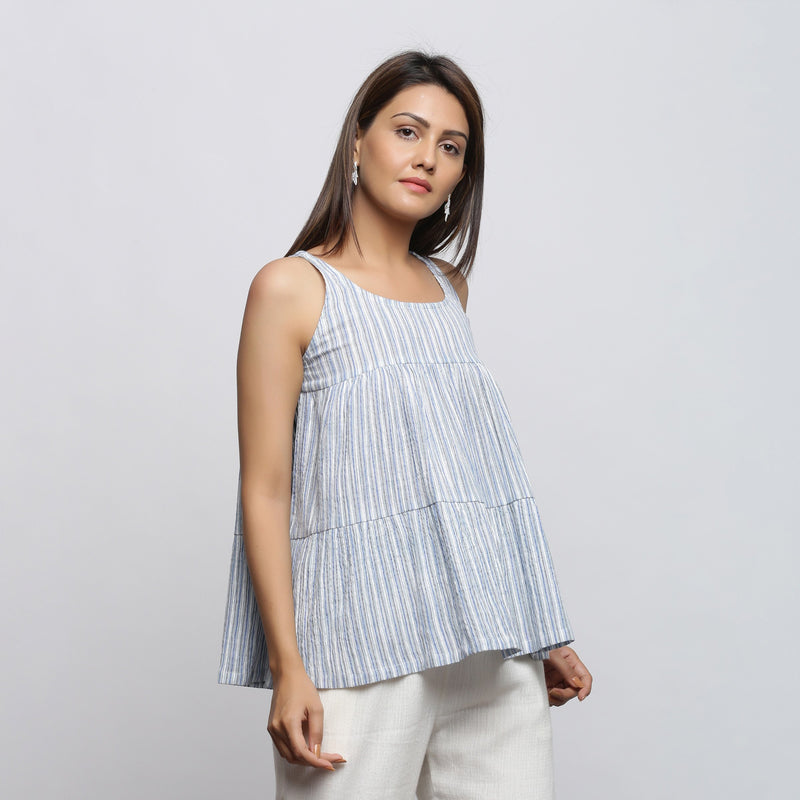 Right View of a Model wearing White and Blue Yarn Dyed Flared Top