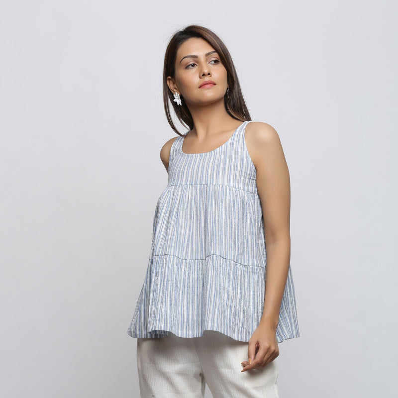 Front View of a Model wearing White and Blue Yarn Dyed Flared Top
