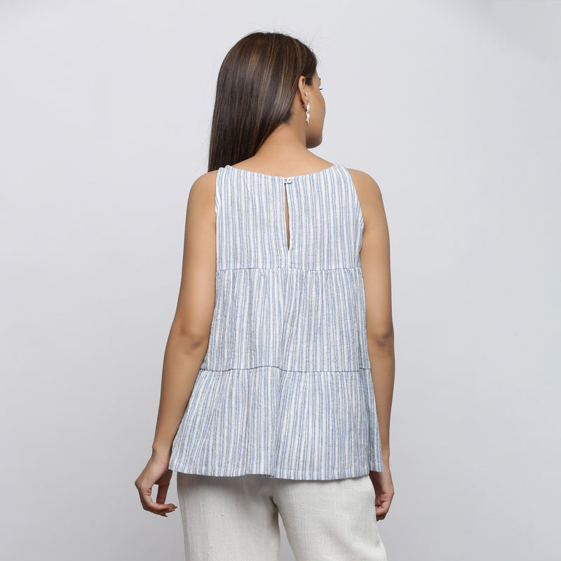 Back View of a Model wearing White and Blue Yarn Dyed Flared Top