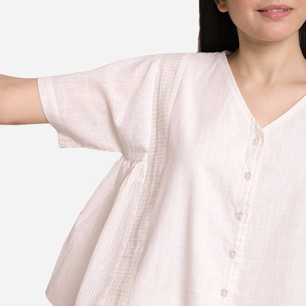Front Detail of a Model wearing White Button-Down Paneled Cotton Top